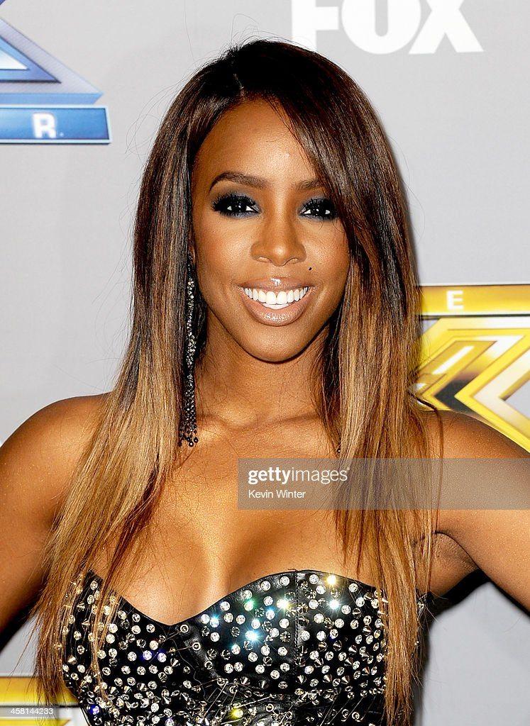 Singer Kelly Rowland poses at Fox's 'The X Factor' Season Finale at CBS Television City on December 19, 2013 in Los Angeles, California.