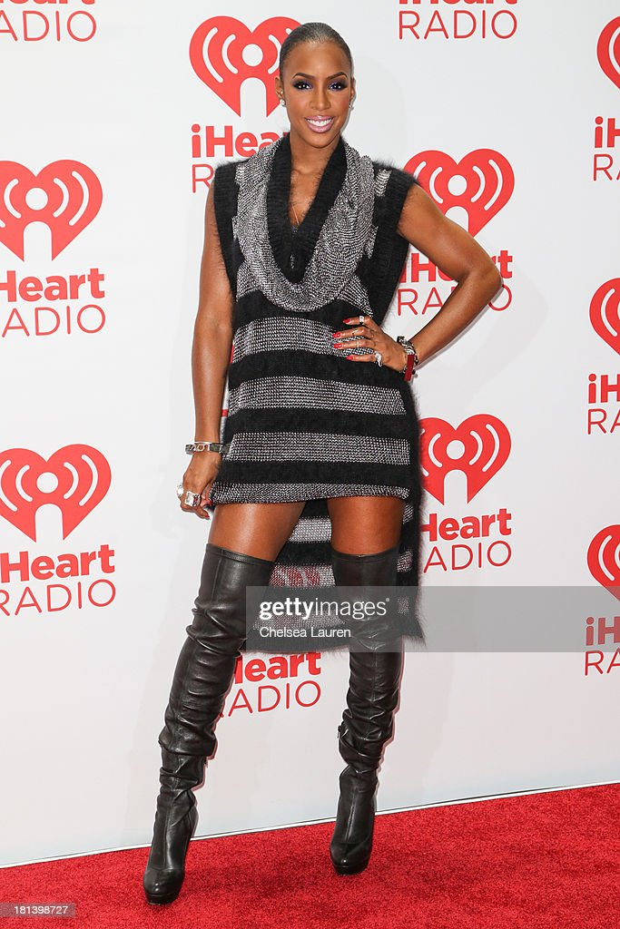 Singer <a gi-track='captionPersonalityLinkClicked' href=/galleries/search?phrase=Kelly+Rowland&family=editorial&specificpeople=201760 ng-click='$event.stopPropagation()'>Kelly Rowland</a> poses in the iHeartRadio music festival photo room on September 20, 2013 in Las Vegas, Nevada.