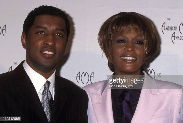 Singer Kenneth 'Babyface' Edmonds and singer Whitney Houston attend the 26th Annual American Music Awards on January 11 1999 at Shrine Auditorium in...