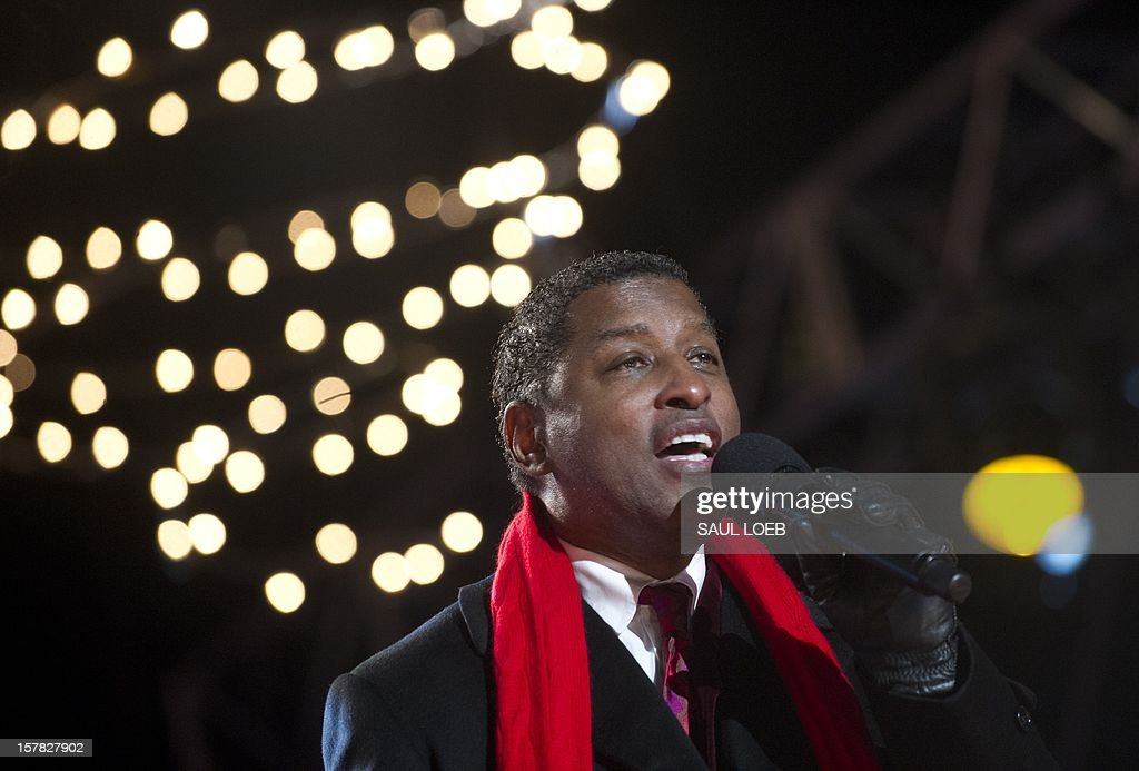 Singer Kenny 'Babyface' Edmonds performs during the National Christmas Tree Lighting on the Ellipse adjacent to the White House in Washington, DC, on December 6, 2012. The annual event, hosted by Actor Neil Patrick Harris, features US President Barack Obama and performances by Jason Mraz, Ledisi, James Taylor, Kenny 'Babyface' Edmonds, Colbie Caillat and American Idol season 11 winner Phillip Phillips. AFP PHOTO / Saul LOEB