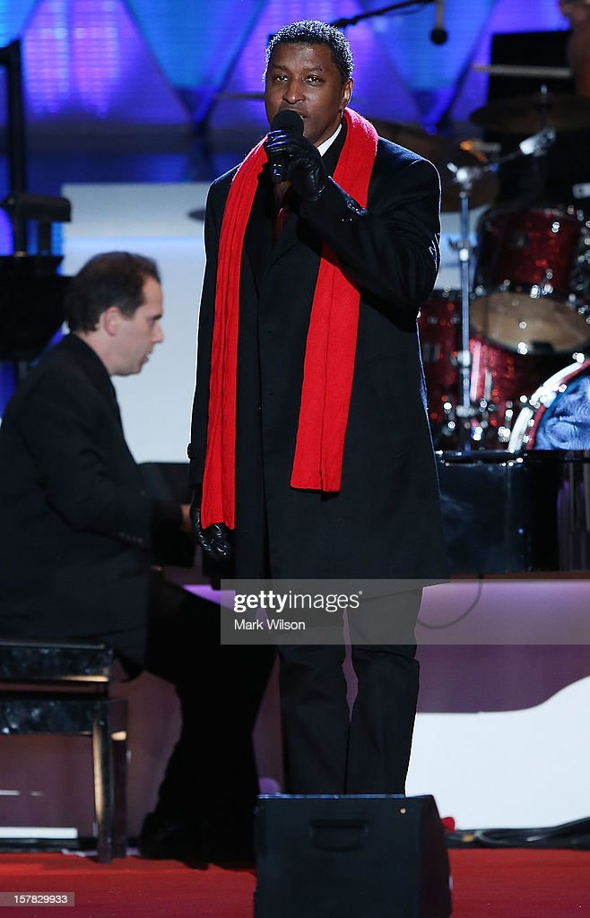 Singer Kenny '<a gi-track='captionPersonalityLinkClicked' href=/galleries/search?phrase=Babyface&family=editorial&specificpeople=227435 ng-click='$event.stopPropagation()'>Babyface</a>' Edmonds sings during the annual lighting of the National Christmas tree on December 6, 2012 in Washington, DC. This year is the 90th annual National Christmas Tree Lighting Ceremony.