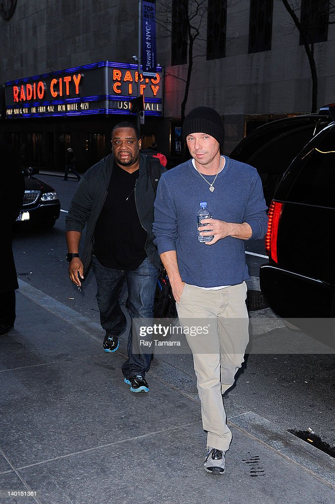 Singer <a gi-track='captionPersonalityLinkClicked' href=/galleries/search?phrase=Kenny+Chesney&family=editorial&specificpeople=209324 ng-click='$event.stopPropagation()'>Kenny Chesney</a> enters the 'Late Night With Jimmy Fallon' taping at the NBC Rockefeller Center Studios on February 28, 2012 in New York City.