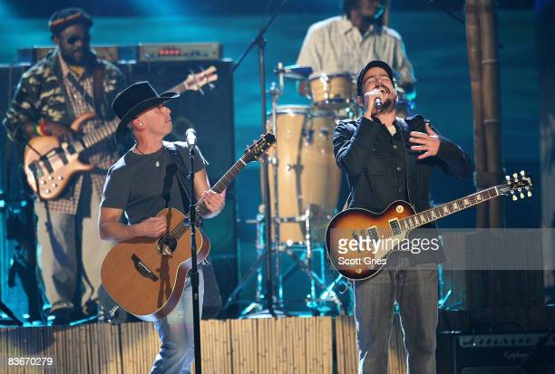 Singer Kenny Chesney performs with The Wailers on stage during the 42nd Annual CMA Awards at the Sommet Center on November 12 2008 in Nashville...