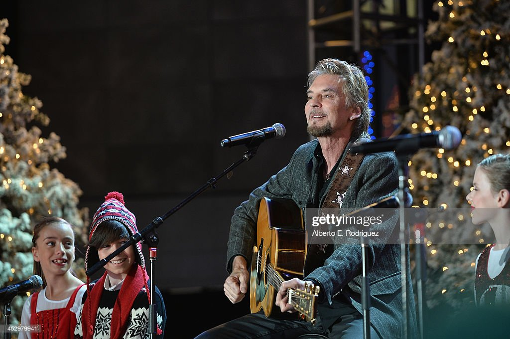 Singer <a gi-track='captionPersonalityLinkClicked' href=/galleries/search?phrase=Kenny+Loggins&family=editorial&specificpeople=640646 ng-click='$event.stopPropagation()'>Kenny Loggins</a> performs at the 82nd Annual Hollywood Christmas Parade on December 1, 2013 in Hollywood, California.