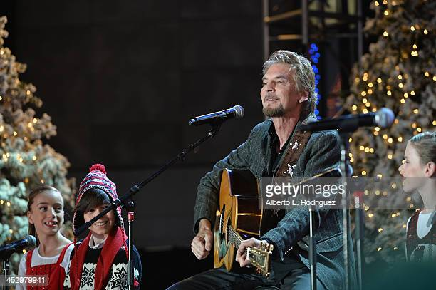 Singer Kenny Loggins performs at the 82nd Annual Hollywood Christmas Parade on December 1 2013 in Hollywood California
