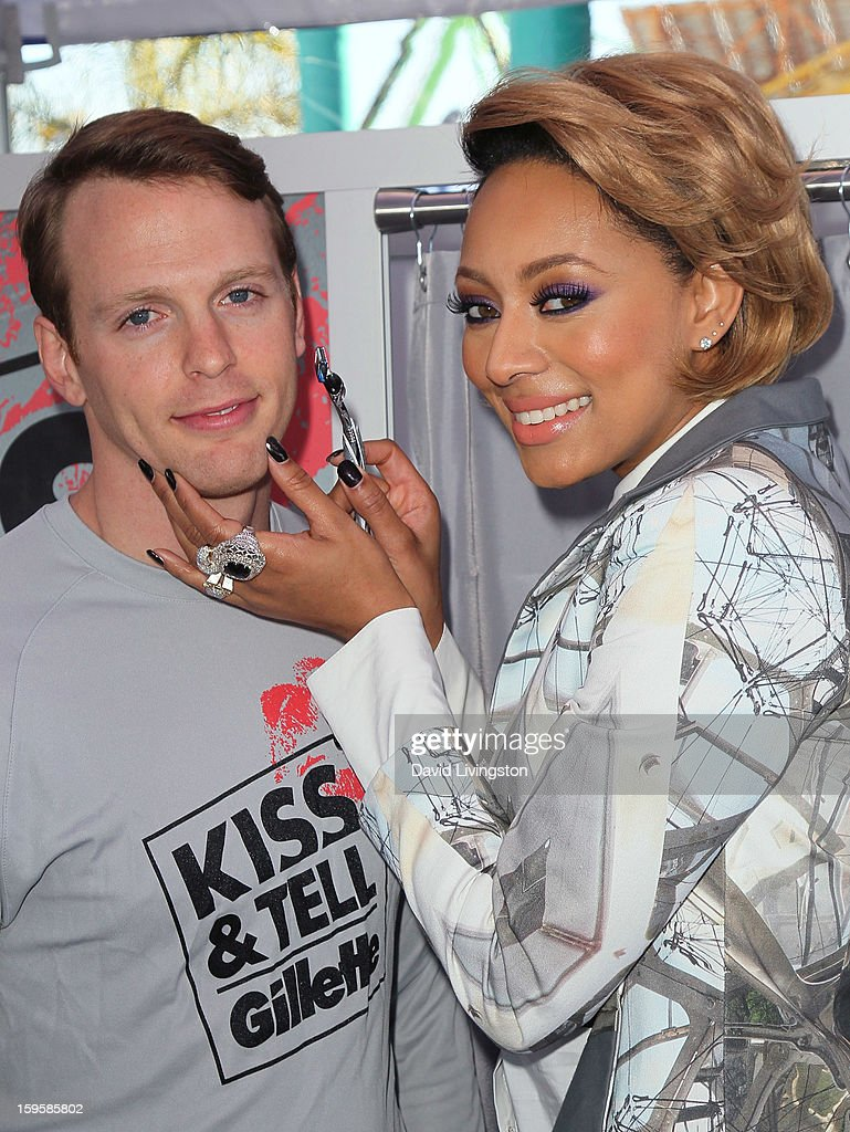 Singer Keri Hilson (R) with model Daniel Hitchingham launch the Gillette 'Kiss & Tell' Experiment on the Santa Monica Pier on January 16, 2013 in Santa Monica, California.