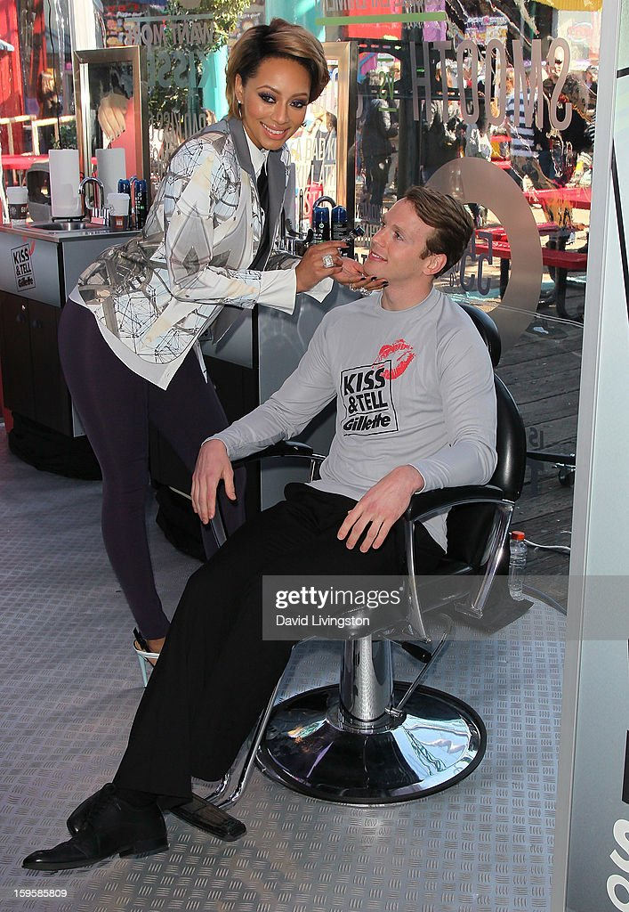 Singer Keri Hilson (L) with model Daniel Hitchingham launch the Gillette 'Kiss & Tell' Experiment on the Santa Monica Pier on January 16, 2013 in Santa Monica, California.