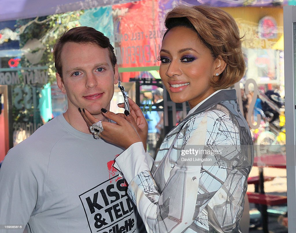 Singer <a gi-track='captionPersonalityLinkClicked' href=/galleries/search?phrase=Keri+Hilson&family=editorial&specificpeople=4340776 ng-click='$event.stopPropagation()'>Keri Hilson</a> (R) with model Daniel Hitchingham launch the Gillette 'Kiss & Tell' Experiment on the Santa Monica Pier on January 16, 2013 in Santa Monica, California.