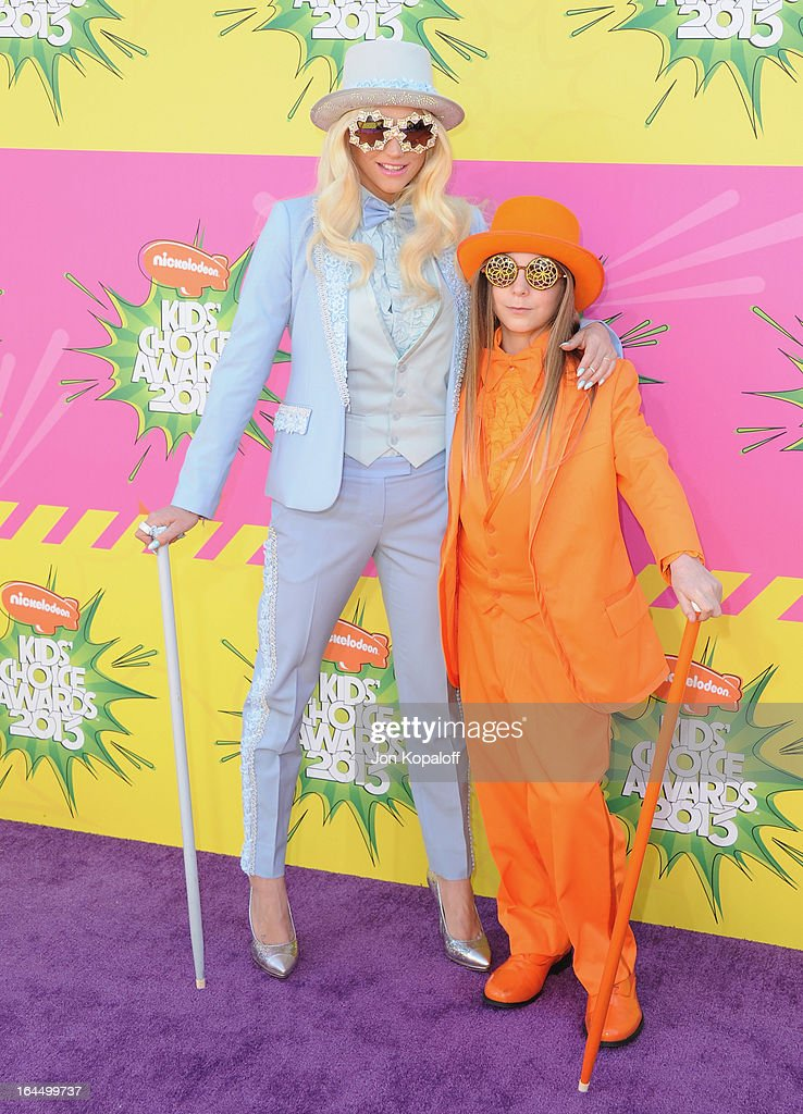 Singer Kesha and brother Louie Sebert arrive at Nickelodeon's 26th Annual Kids' Choice Awards at USC Galen Center on March 23, 2013 in Los Angeles, California.