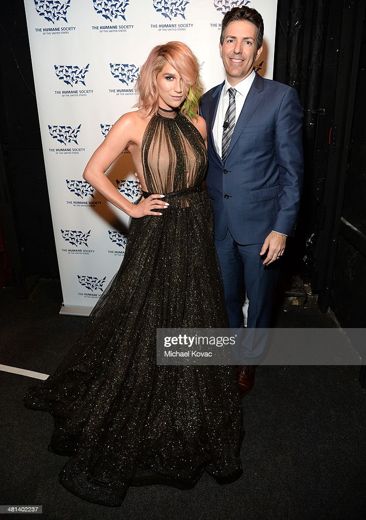 Singer Kesha (L) and President and Chief Executive Officer of the Humane Society of the United States Wayne Pacelle attend the Humane Society of The United States 60th Anniversary Gala at The Beverly Hilton Hotel on March 29, 2014 in Beverly Hills, California.