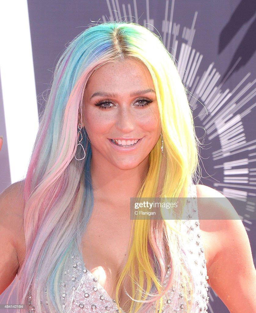 Singer Kesha (Ke$ha) arrives to the 2014 MTV Video Music Awards at The Forum on August 24, 2014 in Inglewood, California.