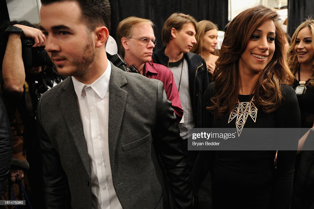 Singer <a gi-track='captionPersonalityLinkClicked' href=/galleries/search?phrase=Kevin+Jonas&family=editorial&specificpeople=709547 ng-click='$event.stopPropagation()'>Kevin Jonas</a> and his wife Danielle Deleasa walk backstage at the Pamella Roland 2013 Fall fashion show during Fall 2013 Mercedes-Benz Fashion Week at Lincoln Center for the Performing Arts on February 11, 2013 in New York City.