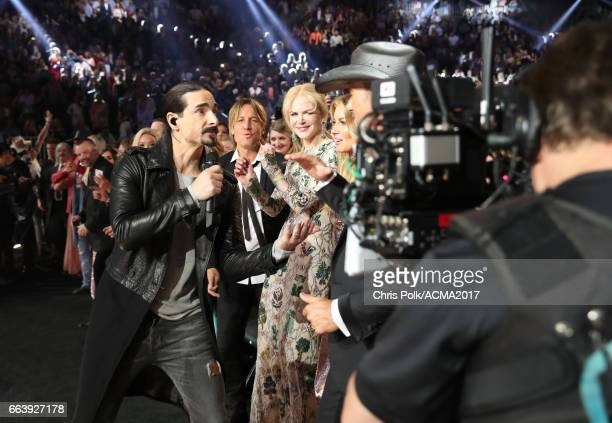 Singer Kevin Richardson of the Backstreet Boys performs while singer Keith Urban actor Nicole Kidman singer Faith Hill and singer Tim McGraw attend...