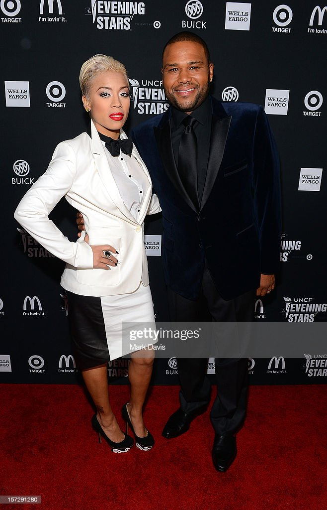 Singer <a gi-track='captionPersonalityLinkClicked' href=/galleries/search?phrase=Keyshia+Cole&family=editorial&specificpeople=563536 ng-click='$event.stopPropagation()'>Keyshia Cole</a> and host <a gi-track='captionPersonalityLinkClicked' href=/galleries/search?phrase=Anthony+Anderson&family=editorial&specificpeople=202577 ng-click='$event.stopPropagation()'>Anthony Anderson</a> arrive at UNCF's 34th Annual An Evening Of Stars held at Pasadena Civic Auditorium on December 1, 2012 in Pasadena, California.