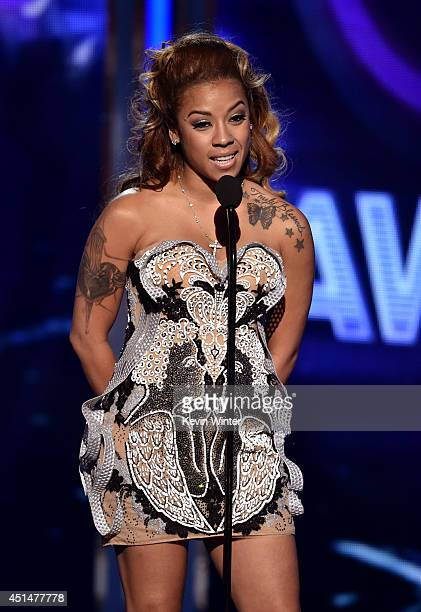 Singer Keyshia Cole speaks onstage during the BET AWARDS '14 at Nokia Theatre LA LIVE on June 29 2014 in Los Angeles California