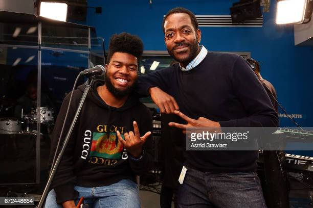 Singer Khalid poses for photos with SiriusXM host Dion Summers before his performance on SiriusXM's The Heat Channel Show at SiriusXM Studios on...