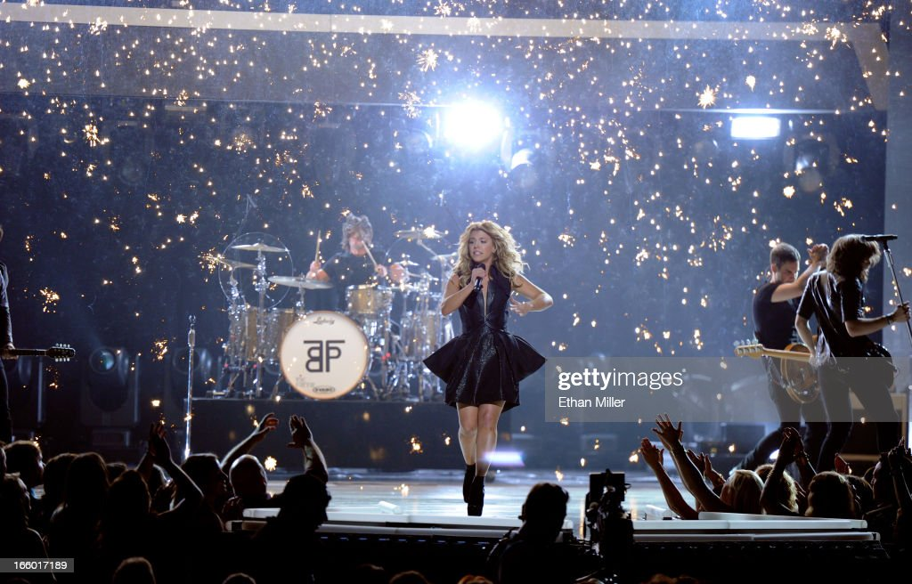 Singer <a gi-track='captionPersonalityLinkClicked' href=/galleries/search?phrase=Kimberly+Perry&family=editorial&specificpeople=6718325 ng-click='$event.stopPropagation()'>Kimberly Perry</a> of The Band Perry performs onstage during the 48th Annual Academy of Country Music Awards at the MGM Grand Garden Arena on April 7, 2013 in Las Vegas, Nevada.