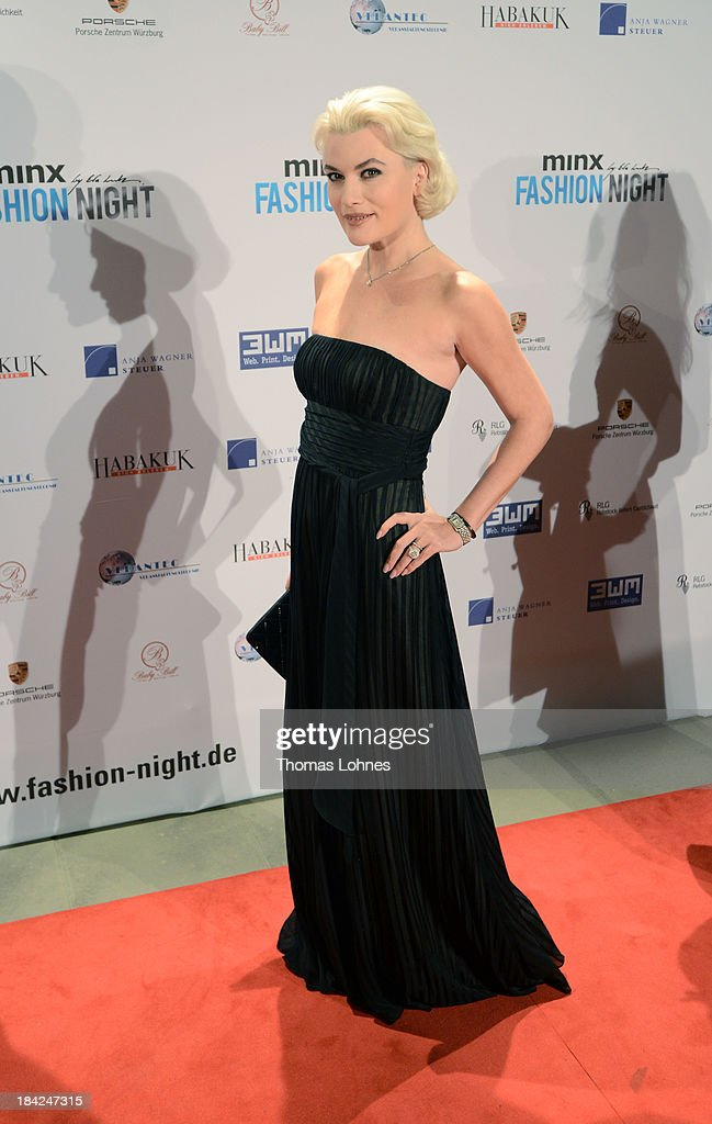Singer Kriemhild Siegel poses during the Minx fashion night at Residenz on October 12, 2013 in Wuerzburg, Germany. The benefit of the charity gala is for the aid organisation 'Sauti Kuu' of Auma Obama. Behind the fashion label Minx stands Eva Lutz.