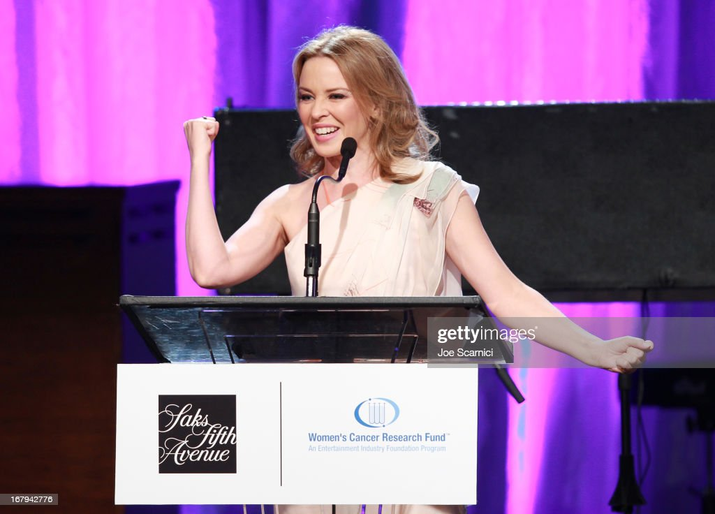 "Singer <a gi-track='captionPersonalityLinkClicked' href=/galleries/search?phrase=Kylie+Minogue&family=editorial&specificpeople=201671 ng-click='$event.stopPropagation()'>Kylie Minogue</a> accepts the 2013 Courage Award onstage during EIF Women's Cancer Research Fund's 16th Annual ""An Unforgettable Evening"" presented by Saks Fifth Avenue at the Beverly Wilshire Four Seasons Hotel on May 2, 2013 in Beverly Hills, California."