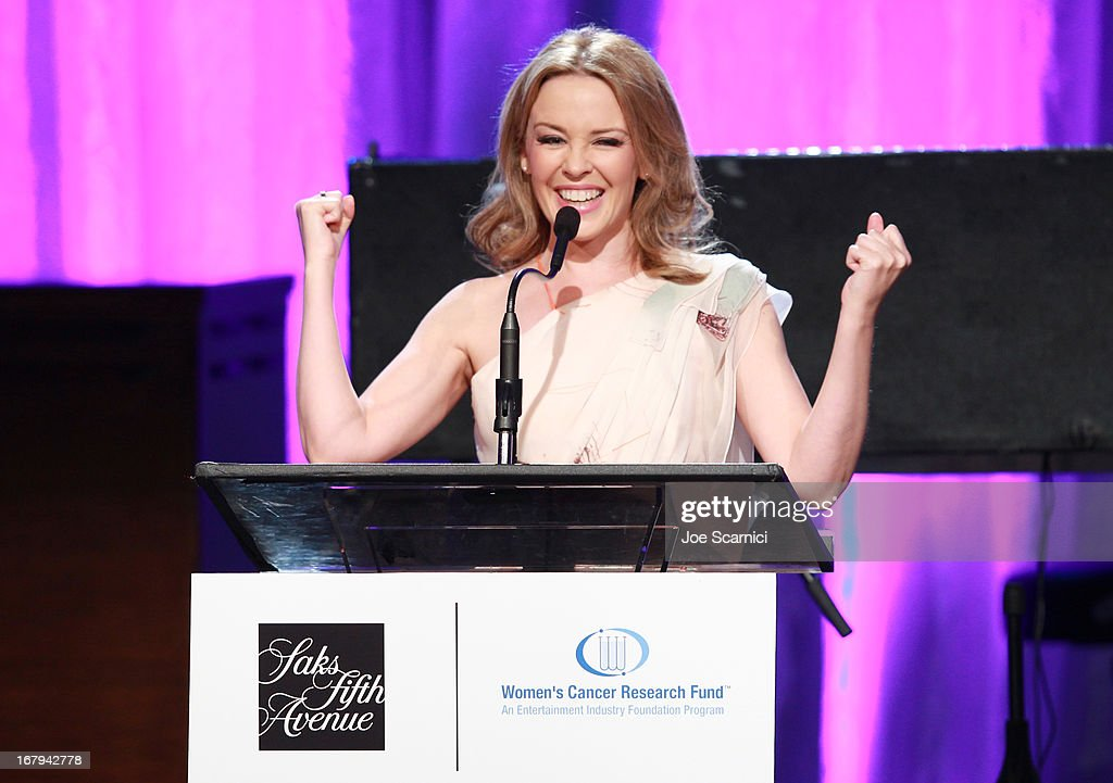 """Singer Kylie Minogue accepts the 2013 Courage Award onstage during EIF Women's Cancer Research Fund's 16th Annual """"An Unforgettable Evening"""" presented by Saks Fifth Avenue at the Beverly Wilshire Four Seasons Hotel on May 2, 2013 in Beverly Hills, California."""