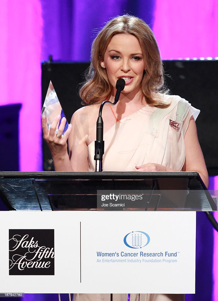 "Singer Kylie Minogue accepts the 2013 Courage Award onstage during EIF Women's Cancer Research Fund's 16th Annual ""An Unforgettable Evening"" presented by Saks Fifth Avenue at the Beverly Wilshire Four Seasons Hotel on May 2, 2013 in Beverly Hills, California."