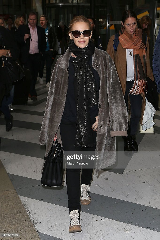 Singer Kylie Minogue arrives at 'Gare du Nord' train station on March 19, 2014 in Paris, France.