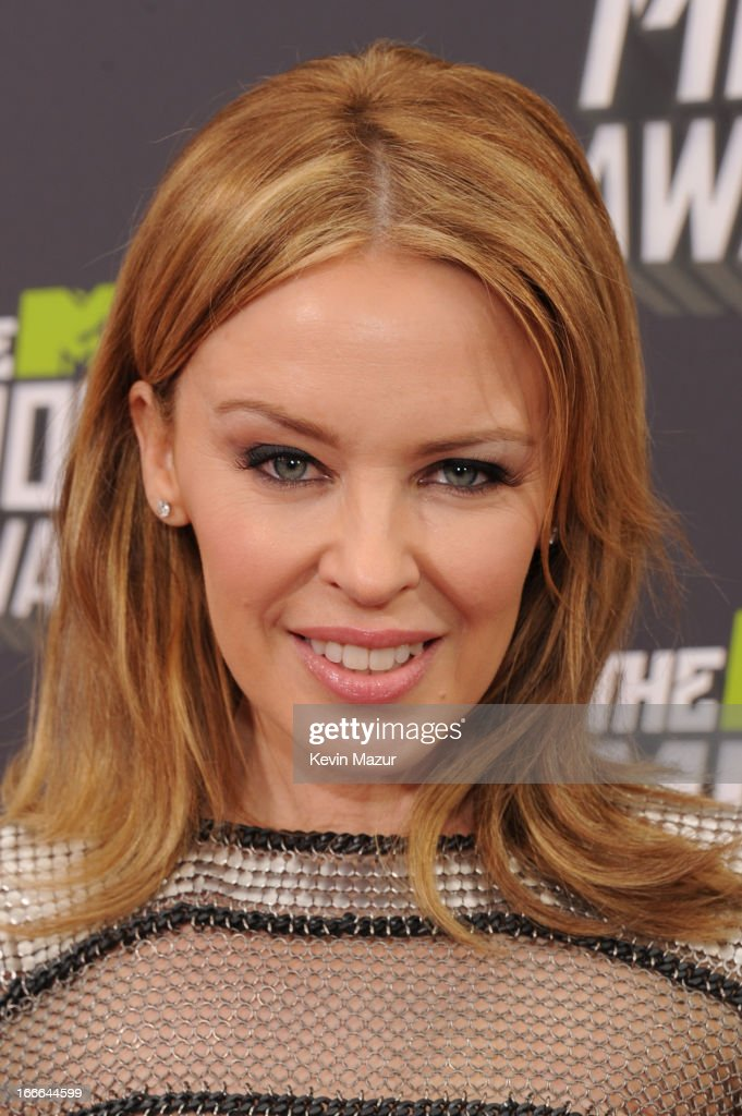 Singer <a gi-track='captionPersonalityLinkClicked' href=/galleries/search?phrase=Kylie+Minogue&family=editorial&specificpeople=201671 ng-click='$event.stopPropagation()'>Kylie Minogue</a> arrives at the 2013 MTV Movie Awards at Sony Pictures Studios on April 14, 2013 in Culver City, California.