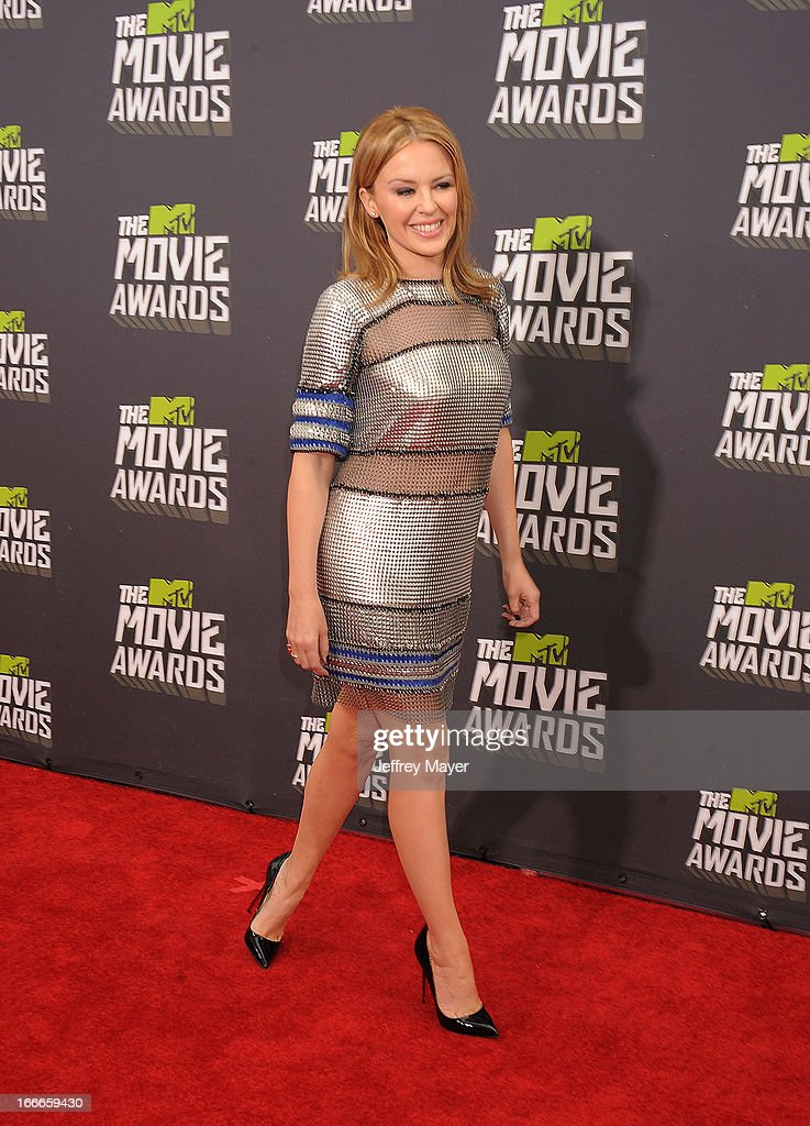 Singer Kylie Minogue arrives at the 2013 MTV Movie Awards at Sony Pictures Studios on April 14, 2013 in Culver City, California.