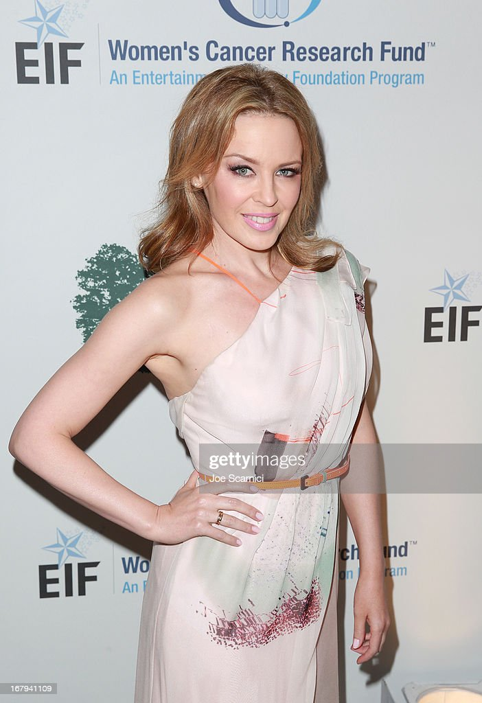 "Singer <a gi-track='captionPersonalityLinkClicked' href=/galleries/search?phrase=Kylie+Minogue&family=editorial&specificpeople=201671 ng-click='$event.stopPropagation()'>Kylie Minogue</a> in Carolina Herrera attends EIF Women's Cancer Research Fund's 16th Annual ""An Unforgettable Evening"" presented by Saks Fifth Avenue at the Beverly Wilshire Four Seasons Hotel on May 2, 2013 in Beverly Hills, California."