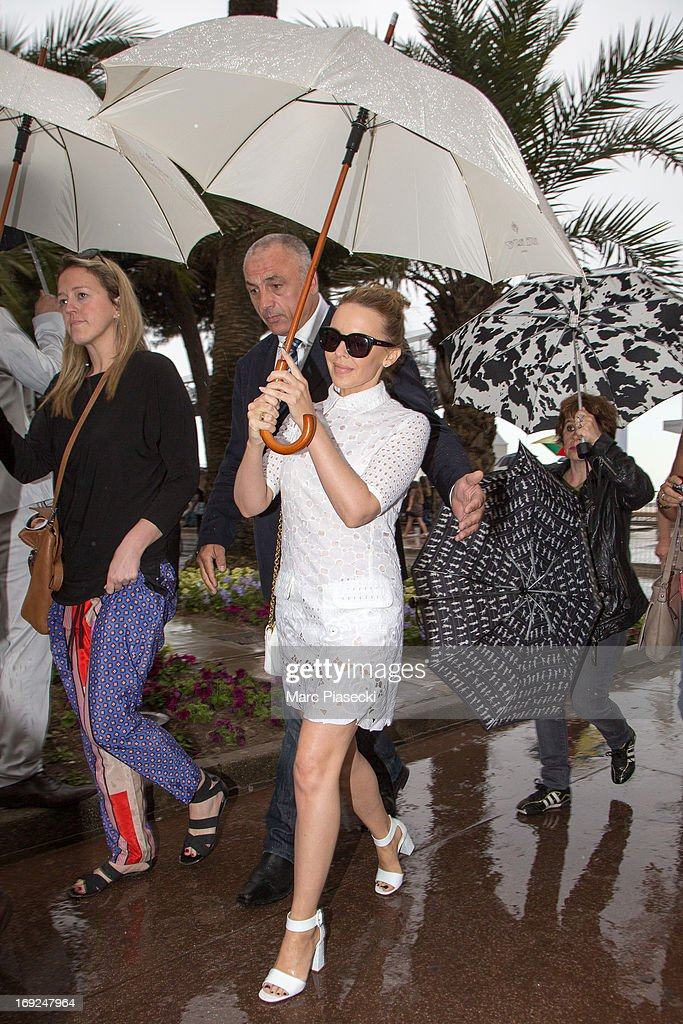 Singer <a gi-track='captionPersonalityLinkClicked' href=/galleries/search?phrase=Kylie+Minogue&family=editorial&specificpeople=201671 ng-click='$event.stopPropagation()'>Kylie Minogue</a> is seen leaving the 'Plage du Martinez' during the 66th Annual Cannes Film Festival on May 22, 2013 in Cannes, France.