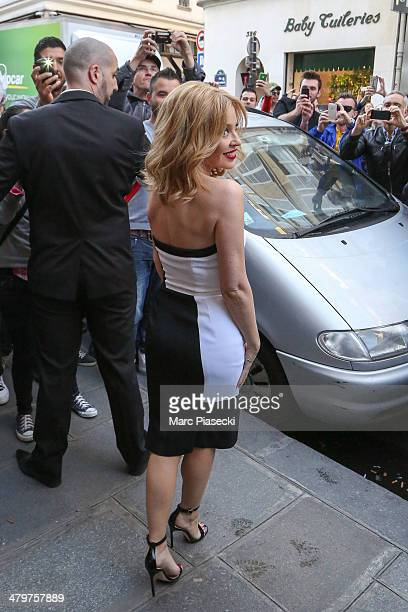 Singer Kylie Minogue leaves the 'COLETTE' store after her new album signing on March 20 2014 in Paris France
