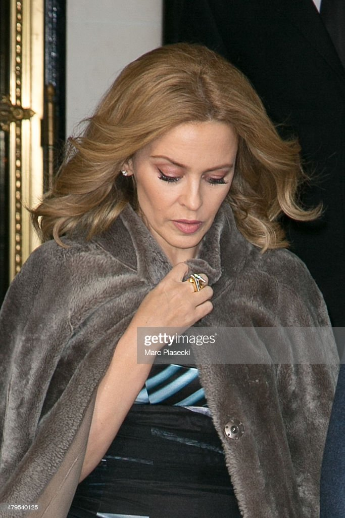 Singer <a gi-track='captionPersonalityLinkClicked' href=/galleries/search?phrase=Kylie+Minogue&family=editorial&specificpeople=201671 ng-click='$event.stopPropagation()'>Kylie Minogue</a> leaves the 'MEURICE' hotel on March 19, 2014 in Paris, France.