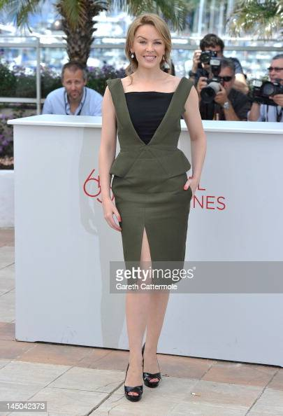 Singer Kylie Minogue poses at the 'Holy Motors' Photocall during the 65th Annual Cannes Film Festival at Palais des Festivals on May 23 2012 in...