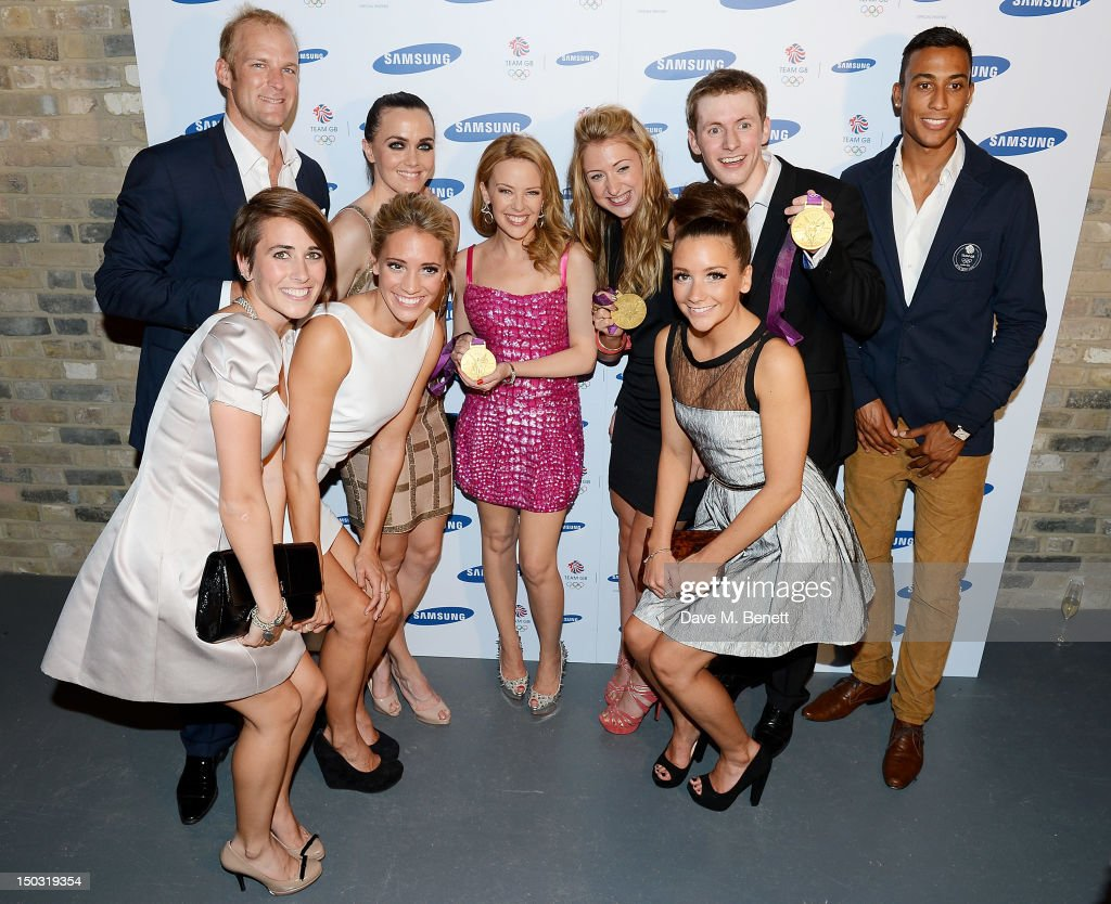 Singer <a gi-track='captionPersonalityLinkClicked' href=/galleries/search?phrase=Kylie+Minogue&family=editorial&specificpeople=201671 ng-click='$event.stopPropagation()'>Kylie Minogue</a> (C) poses with Olympians <a gi-track='captionPersonalityLinkClicked' href=/galleries/search?phrase=Alex+Partridge&family=editorial&specificpeople=217595 ng-click='$event.stopPropagation()'>Alex Partridge</a>, Emily Pidgeon, <a gi-track='captionPersonalityLinkClicked' href=/galleries/search?phrase=Jenna+Randall&family=editorial&specificpeople=801148 ng-click='$event.stopPropagation()'>Jenna Randall</a>, <a gi-track='captionPersonalityLinkClicked' href=/galleries/search?phrase=Victoria+Pendleton&family=editorial&specificpeople=228525 ng-click='$event.stopPropagation()'>Victoria Pendleton</a>, <a gi-track='captionPersonalityLinkClicked' href=/galleries/search?phrase=Laura+Trott+-+Cyclist&family=editorial&specificpeople=7205074 ng-click='$event.stopPropagation()'>Laura Trott</a>, Asha Randall, <a gi-track='captionPersonalityLinkClicked' href=/galleries/search?phrase=Jason+Kenny&family=editorial&specificpeople=4167086 ng-click='$event.stopPropagation()'>Jason Kenny</a> and <a gi-track='captionPersonalityLinkClicked' href=/galleries/search?phrase=Andrew+Osagie&family=editorial&specificpeople=5101846 ng-click='$event.stopPropagation()'>Andrew Osagie</a> at the Samsung Galaxy Note 10.1 launch party at One Mayfair on August 15, 2012 in London, England.