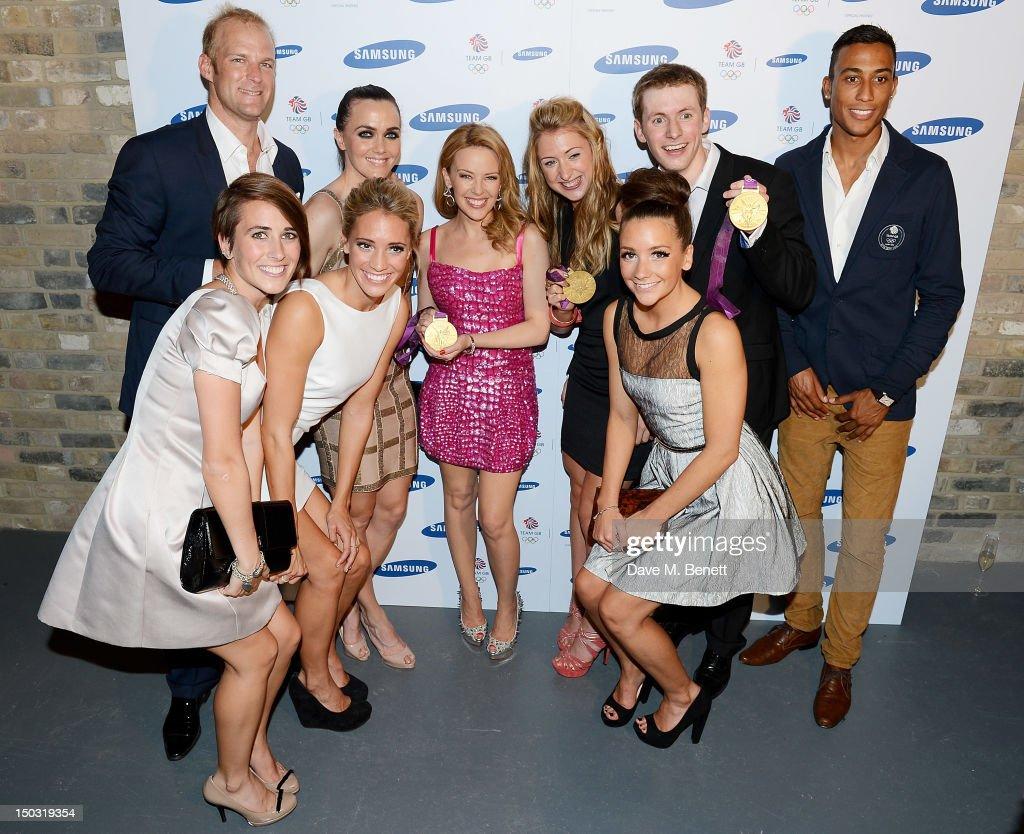 Singer Kylie Minogue poses with Olympians Alex Partridge Emily Pidgeon Jenna Randall Victoria Pendleton Laura Trott Asha Randall Jason Kenny and...