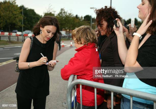 Singer Kylie Minogue signs autographs as she arrives at Anglia Ruskin University before receiving an honorary degree in Chelmsford Essex