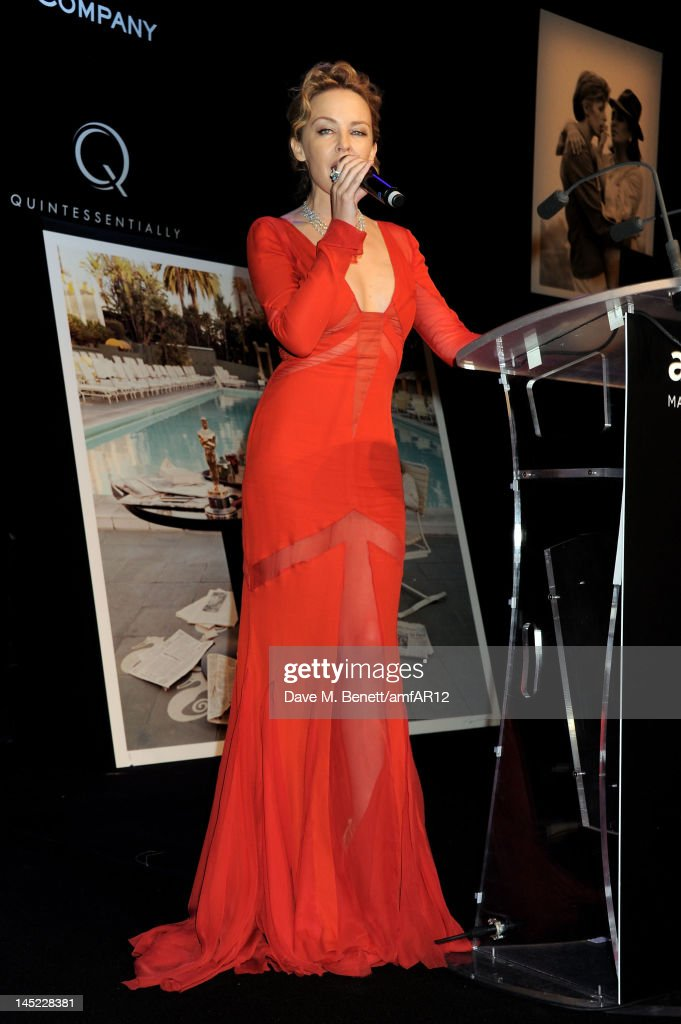 Singer <a gi-track='captionPersonalityLinkClicked' href=/galleries/search?phrase=Kylie+Minogue&family=editorial&specificpeople=201671 ng-click='$event.stopPropagation()'>Kylie Minogue</a> speaks at the 2012 amfAR's Cinema Against AIDS during the 65th Annual Cannes Film Festival at Hotel Du Cap on May 24, 2012 in Cap D'Antibes, France.
