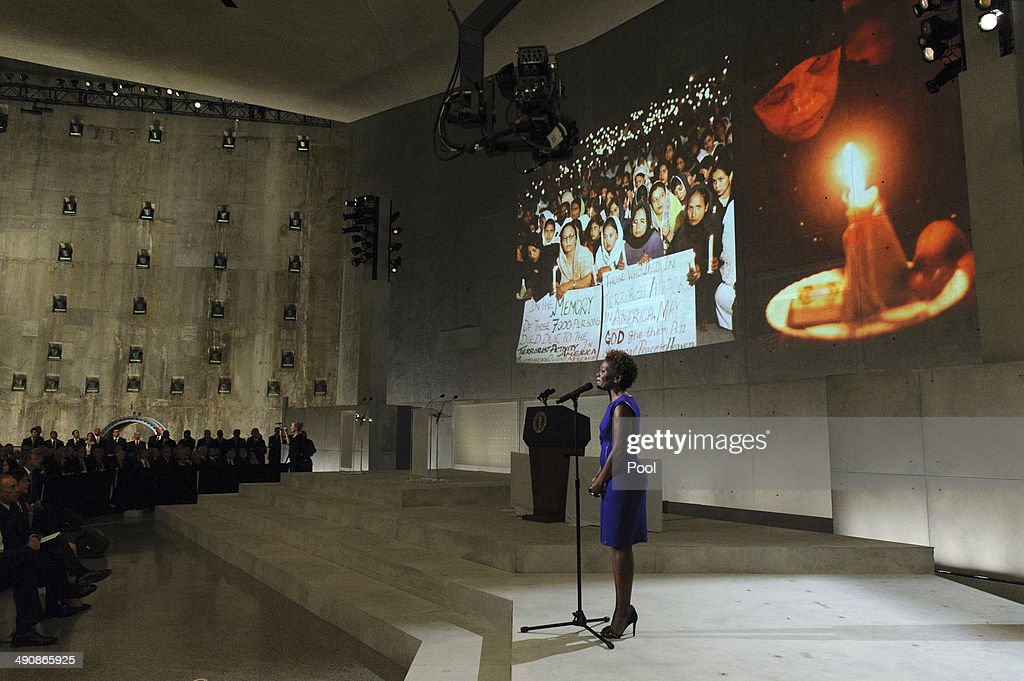 Singer LaChanze, who lost her husband in the September 11 2001 attacks on the World Trade Center sings Amazing Grace during the opening ceremony for the National September 11 Memorial Museum at ground zero May 15, 2014 in New York City. The museum spans seven stories, mostly underground, and contains artifacts from the attack on the World Trade Center Towers on September 11, 2001 that include the 80 ft high tridents, the so-called 'Ground Zero Cross,' the destroyed remains of Company 21's New York Fire Department Engine as well as smaller items such as letter that fell from a hijacked plane and posters of missing loved ones projected onto the wall of the museum. The museum will open to the public on May 21.