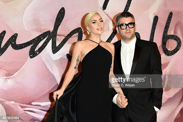 Singer Lady Gaga and desginer Brandon Maxwell attend The Fashion Awards 2016 on December 5 2016 in London United Kingdom