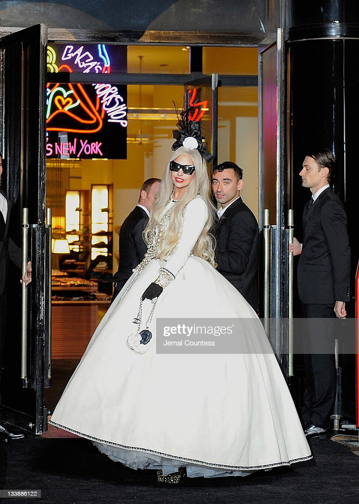 Singer <a gi-track='captionPersonalityLinkClicked' href=/galleries/search?phrase=Lady+Gaga&family=editorial&specificpeople=4456754 ng-click='$event.stopPropagation()'>Lady Gaga</a> and designer <a gi-track='captionPersonalityLinkClicked' href=/galleries/search?phrase=Nicola+Formichetti&family=editorial&specificpeople=7376980 ng-click='$event.stopPropagation()'>Nicola Formichetti</a> pose for a photo after cutting the ribbon opening 'Gaga's Workshop' at Barneys during the opening of Gaga's Workshop at Barneys New York on November 21, 2011 in New York City.
