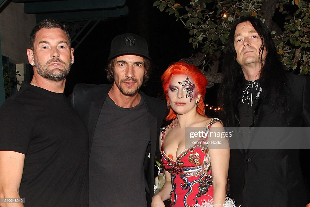 Singer Lady Gaga (C) and guests attend the Absolut Elyx Hosts Mark Ronson's Grammy's Afterparty at Elyx House Los Angeles on February 15, 2016 in Los Angeles, California.