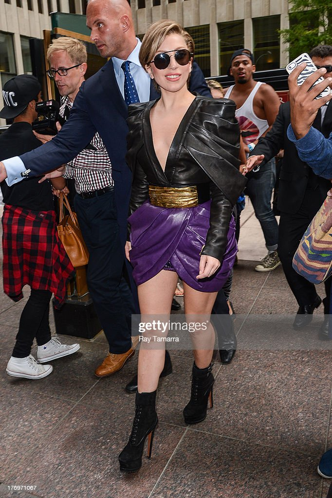 Singer Lady Gaga enters the Sirius XM Studios on August 19, 2013 in New York City.