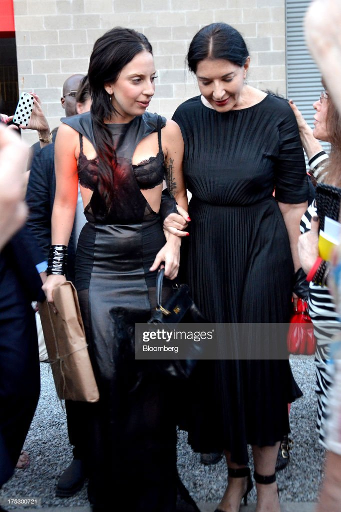 Singer Lady Gaga, left, and performance artist Marina Abramovic attend the 20th annual Watermill Center benefit in Water Mill, New York, U.S., on Saturday, July 27, 2013. The event raised $1.85 million. Photographer: Amanda Gordon/Bloomberg via Getty Images