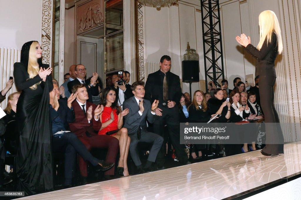 Singer Lady Gaga Mario Testino singer Alan Ritchson Karine Ferri and actor Nolan Gerard Funk greet Donatella Versace at the end of the Atelier...