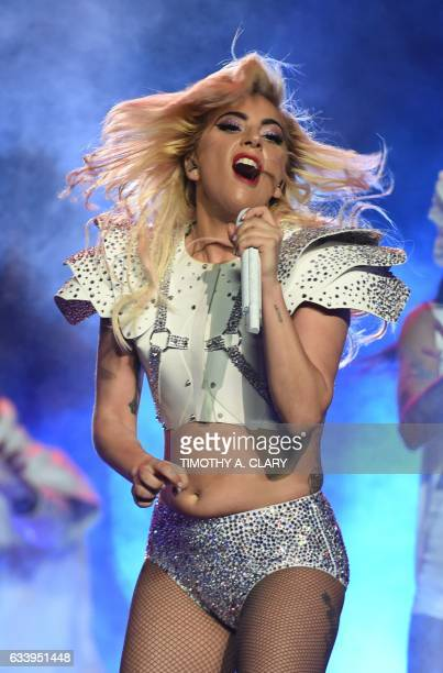 Singer Lady Gaga performs during the halftime show of Super Bowl LI at NGR Stadium in Houston Texas on February 5 2017 / AFP PHOTO / Timothy A CLARY