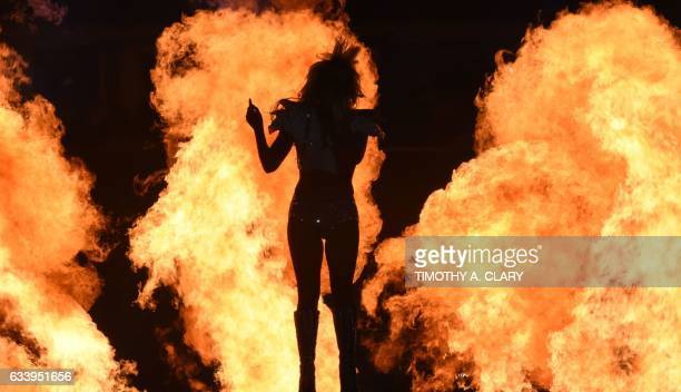 TOPSHOT Singer Lady Gaga performs during the halftime show of Super Bowl LI at NGR Stadium in Houston Texas on February 5 2017 / AFP PHOTO / Timothy...
