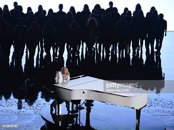 TOPSHOT Singer Lady Gaga performs on stage at the 88th Oscars on February 28 2016 in Hollywood California AFP PHOTO / MARK RALSTON / AFP / MARK...