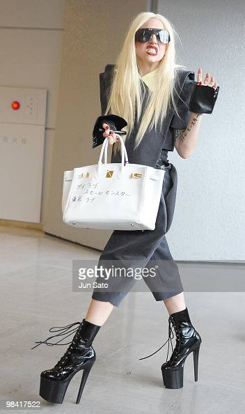 Singer Lady Gaga shows her Hermes bag with hand written message 'I love small monster Tokyo Love' at Narita International Airport on April 13 2010 in...