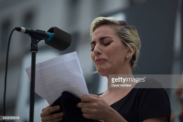 Singer Lady Gaga tries not to cry while reading some of the names of the dead at a vigil for the worst mass shooing in United States history on June...