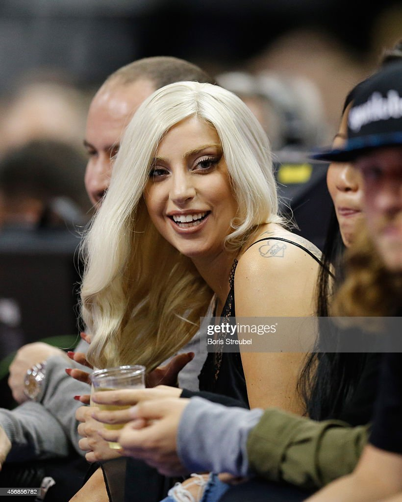 Singer Lady Gaga visits the NBA Global Games Tour 2014 match between Alba Berlin and San Antonio Spurs at O2 World on October 8, 2014 in Berlin, Germany.